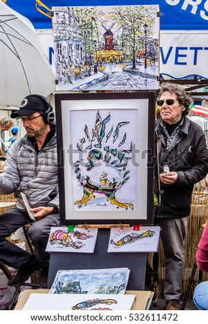 PARIS, FRANCE - JUNE 9, 2015: Artists easels and artwork set up in Place du Tertre in Montmartre. Montmartre attracted many famous modern artists including Picasso and Dali.