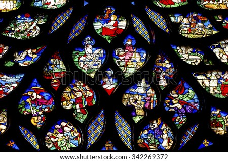 PARIS, FRANCE -  JUNE 1, 2015 Biblical Medieval Stories Horses Angels  Rose Window Stained Glass Saint Chapelle Paris France.  St King Louis 9th created Chapelle and stained glass in 1248. - stock photo