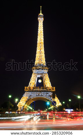 PARIS, FRANCE - JUNE 5 2015: Eiffel Tower at night is the most visited monument in France and the most famous symbol of Paris, June 5, 2015