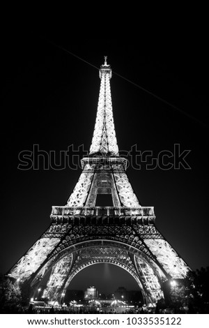 Paris, France-June 1, 2016 : Eiffel Tower with illumination at night in Paris, France. Romantic travel background. Eiffel tower is traditional symbol of paris and love.