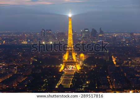 PARIS, FRANCE - JUNE 17, 2015: Evening view on Paris and the Eiffel Tower. The Eiffel tower was erected in 1889 and has become both a global cultural icon of France and the world. - stock photo