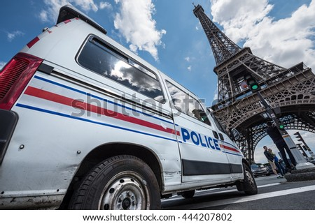 Paris, FRANCE - June 26, 2016 : French police car parked in front of the Eiffel Tower during the Euro 2016. - stock photo