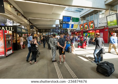 PARIS, FRANCE - June 13, 2014: Interios view of Paris Montparnasse TGV train station; passengers checking at timetable. - stock photo
