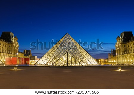 PARIS, FRANCE - JUNE 18 : night scene of the Louvre Museum in Paris on June 18, 2015. Louvre Museum is one of the most popular museums of the world. - stock photo