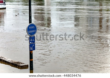 Paris, France - June 03, 2016: Seine river water flooding after major rainfalls. Street signs underwater.