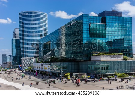 PARIS, FRANCE - JUNE 3, 2015: Skyscrapers in business district of Defense to the west of Paris. Defense is biggest business district in France and most of large companies have offices here. - stock photo
