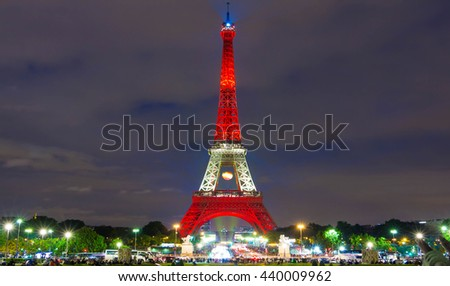 paris; France-June 13, 2016 : The Eiffel tower lit up in color of Spain's flag for  soccer Europe championship 2016  in France. The Eiffel tower is on of the most visited monuments in the world. - stock photo