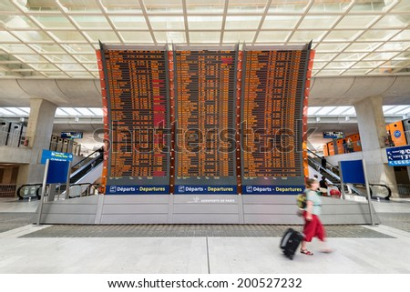 PARIS, FRANCE - June 12, 2014: Timetable of Charles De Gaulle Airport at Terminal 2. - stock photo