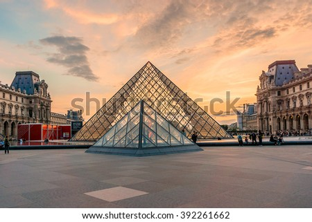 PARIS, FRANCE - JUNE 10, 2015: View of famous Louvre Museum with Louvre Pyramid at evening. Louvre Museum is one of the largest and most visited museums worldwide. - stock photo