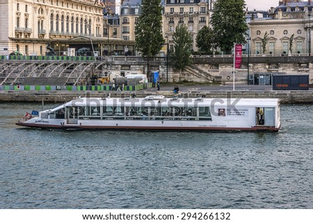PARIS, FRANCE - JUNE 10, 2015: View of the embankment of the river Seine at sunset.