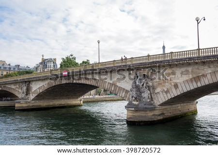 PARIS, FRANCE - JUNE 6, 2015: View of the Seine River with cruise tour boats. In Paris there are several boat tourist trips across the Seine to show tourists the sights of interest.