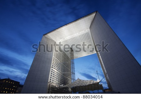 Paris, France - La Grande Arche de la defense illuminated at dusk - stock photo
