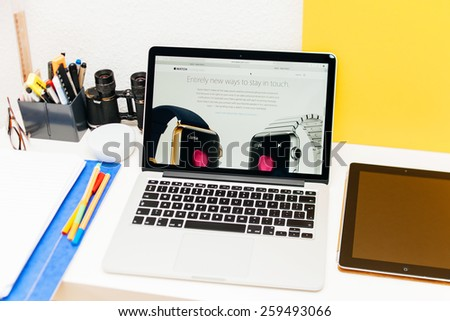 PARIS, FRANCE - MAR 10, 2015: Apple Computers website on MacBook Retina in room environment showcasing Apple Watch as a entirely new way to stay in touch as seen on 10 March, 2015 - stock photo