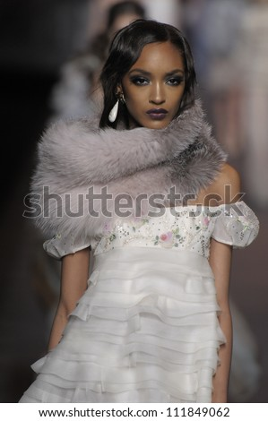 PARIS, FRANCE - MARCH 04: A model walks runway during the Christian Dior Ready to Wear Autumn/Winter 2011/2012 show during Paris Fashion Week at Musee Rodin on March 4, 2011 in Paris, France. - stock photo