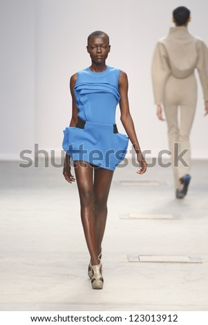PARIS, FRANCE - MARCH 04: A model walks the runway during the Amaya Arzuaga Ready to Wear Autumn/Winter 2011/2012 show during Paris Fashion Week on March 4, 2011 in Paris, France - stock photo