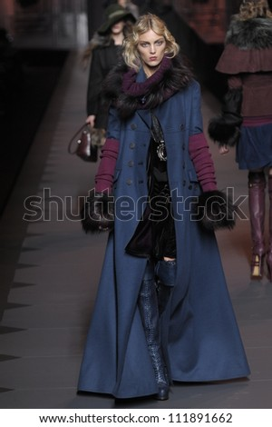 PARIS, FRANCE - MARCH 04: A model walks the runway during the Christian Dior Ready to Wear Autumn/Winter 2011/2012 show during Paris Fashion Week at Musee Rodin on March 4, 2011 in Paris, France. - stock photo