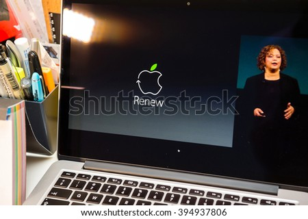 PARIS, FRANCE - MARCH 21, 2016: Apple Computers website on MacBook Pro Retina in a creative room environment showcasing Apple Event with Lisa Jackson amd Renew recycle programm - stock photo