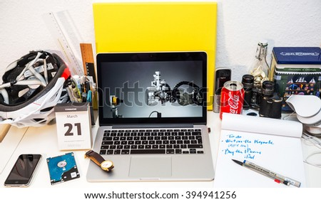 PARIS, FRANCE - MARCH 21, 2016: Apple Computers website on MacBook Pro Retina in a creative room with Lisa Jackson presenting a robot that can break down and separate materials in iPhones for future  - stock photo