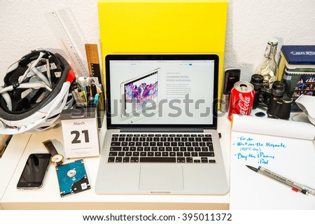 PARIS, FRANCE - MARCH 21, 2016: Apple Computers website on MacBook Pro Retina in a geek creative room environment showcasing the newly announced iPAd pro and its revolutionary Apple Pencil - stock photo