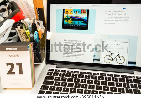 PARIS, FRANCE - MARCH 21, 2016: Apple Computers website on MacBook Pro Retina in a geek creative room environment showcasing the newly announced iPad Pro and Ture Tone - stock photo