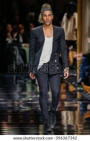 PARIS, FRANCE - MARCH 03: Designer Olivier Rousteing walks the runway during the Balmain show as part of the Paris Fashion Week Womenswear Fall/Winter 2016/2017 on March 3, 2016 in Paris, France. - stock photo
