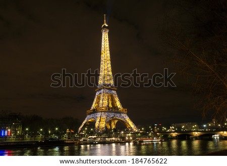 PARIS,FRANCE - MARCH 15, 2010: Eiffel tower at night . Night in Paris with Eiffel tower, most visited monument of France with 200.000.000 visit - stock photo