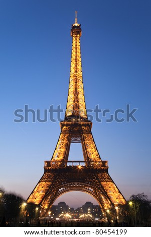 PARIS, FRANCE - MARCH 24: Lights from the Eiffel Tower illuminate the night sky on March 24, 2011 in Paris, France. The light show is established in 1985 and as of February 2003 it has 20,000 light bulbs - stock photo
