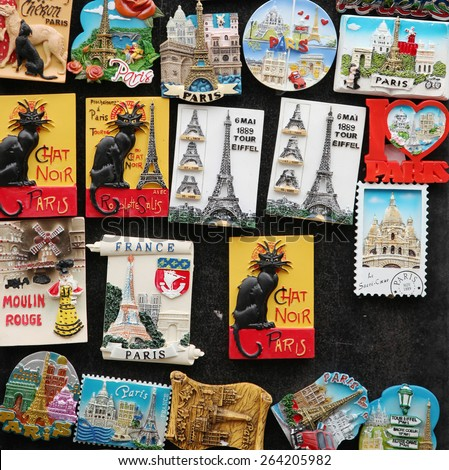 PARIS, FRANCE, MARCH 03 2015:  Magnets of eiffel tower, chat noir on a wall,  Great souvenirs of Paris, France. - stock photo