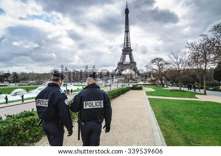 Paris, France - March 18, 2012: Patrols of two police officers in the Trocadero gardens and Eiffel Tower. - stock photo