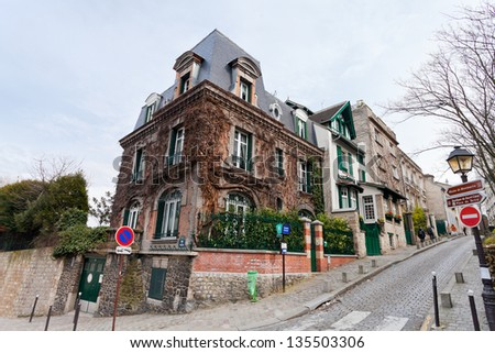 PARIS, FRANCE - MARCH 5: rue des Saules (Street of Willows). Famous street of old Montmartre, it was immortalized by including Paul Cezanne,Vincent van Gogh, Maurice Utrillo, in Paris on March 5, 2013 - stock photo