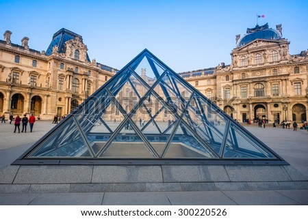 PARIS, FRANCE- March 21: The large glass pyramid and the main courtyard of the Louvre Museum on march 21, 2015. The Louvre Museum is one of the largest museums of the world - stock photo