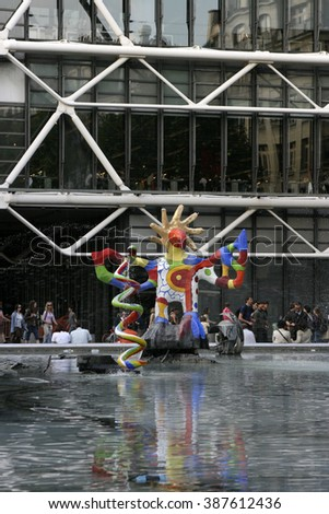 Paris, France - May 3, 2007: A colorful sculpture in the Stravinsky Fountain next to the Pompidou Center attracts tourists on a spring day.