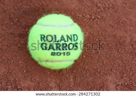 PARIS, FRANCE- MAY 24, 2015: Babolat Roland Garros 2015 tennis ball at Le Stade Roland Garros in Paris, France. Babolat is an Official Partner of the tournament and provides racquets, balls, strings - stock photo
