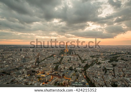 PARIS, FRANCE - May 18, 2016: Beautiful view of illuminated Eiffel tower, the city and a dramatic sky.