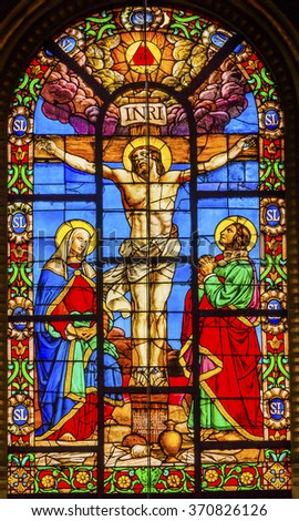 PARIS, FRANCE -  MAY 31, 2015 Crucifixion Jesus Virgin Mary Marcy Madeline Stained Glass Saint Louis En L'ile Church Paris France. Church built in 1726 on the island in back of Nortre Dame.   - stock photo