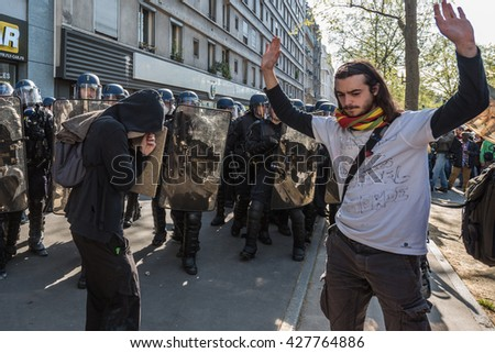 Paris, FRANCE - MAY 17, 2016 : Demonstrators inf front of french police, anti-riot squad, during the massive protest over the labor law reforms. - stock photo