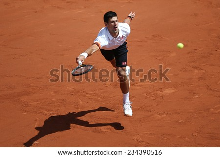 PARIS, FRANCE- MAY 30, 2015: Eight times Grand Slam champion Novak Djokovic during third round match at Roland Garros 2015 in Paris, France - stock photo