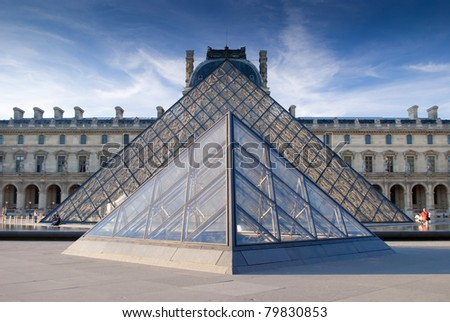 PARIS,FRANCE - MAY 26: Entry to Louvre Museum on May 26, 2011 in Paris. The large pyramid was completed in 1989, it has become a landmark of the city of Paris. - stock photo