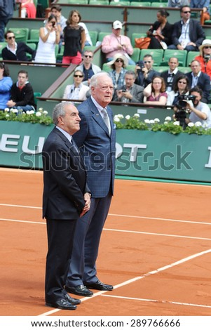 PARIS, FRANCE- MAY 30, 2015: Former tennis champion Fred Stolle, of Australia,  and French Tennis Federation president Jean Gachassin during a symbolic trophy presentation at the Roland Garros stadium - stock photo