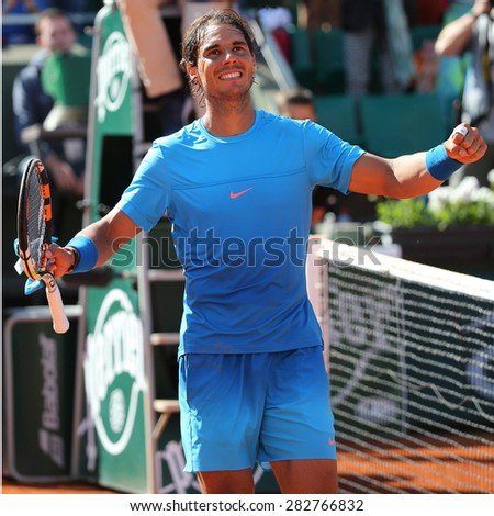 PARIS, FRANCE- MAY 30, 2015:Fourteen times Grand Slam champion Rafael Nadal celebrates victory after third round match at Roland Garros 2015 in Paris, France - stock photo