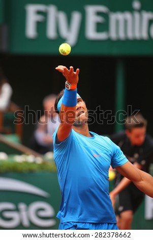 PARIS, FRANCE- MAY 26, 2015:Fourteen times Grand Slam champion Rafael Nadal during first round match at Roland Garros 2015 in Paris, France - stock photo