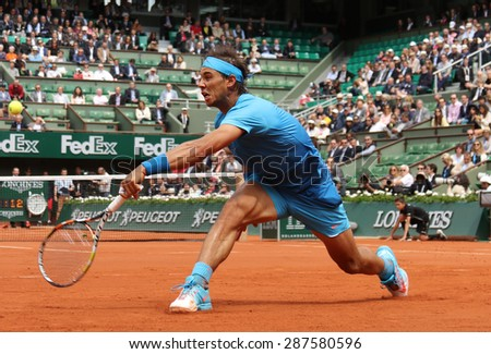 PARIS, FRANCE- MAY 28, 2015:Fourteen times Grand Slam champion Rafael Nadal during second round match at Roland Garros 2015 in Paris, France - stock photo