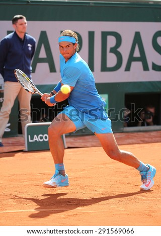 PARIS, FRANCE- MAY 26, 2015:Fourteen times Grand Slam champion Rafael Nadal in action during his first round match at Roland Garros 2015 in Paris, France - stock photo