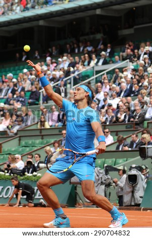 PARIS, FRANCE- MAY 28, 2015:Fourteen times Grand Slam champion Rafael Nadal in action during second round match at Roland Garros 2015 in Paris, France - stock photo