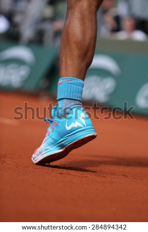PARIS, FRANCE- MAY 30, 2015:Fourteen times Grand Slam champion Rafael Nadal wears custom Nike tennis shoes during third round match at Roland Garros 2015 in Paris, France - stock photo