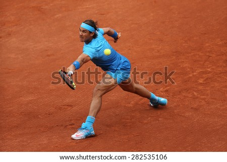 PARIS, FRANCE- MAY 28, 2015:Fourteen times Grand Slam champion Roger Federer during second round match at Roland Garros 2015 in Paris, France - stock photo