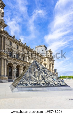PARIS, FRANCE - MAY 8, 2014: Glass pyramid at courtyard of Louvre Museum. Louvre Museum is one of the largest and most visited museums worldwide.