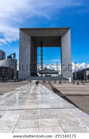 "PARIS, FRANCE - MAY 13, 2014: Grand Arch (""Grande Arche de la Defense"", 1989) - a monument in business district of Defense to west of Paris. Arch is a monument to humanity and humanitarian ideals."