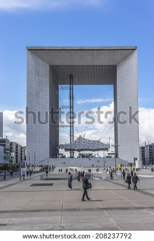 "PARIS, FRANCE - MAY 13, 2014: ""Grande Arche de la Defense"" (1989) - a monument in business district of Defense to west of Paris. Arch is a monument to humanity and humanitarian ideals."