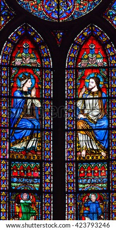 PARIS, FRANCE - MAY 31, 2016 Jesus Christ Mary Angels Stained Glass Notre Dame Cathedral Paris France.  Notre Dame was built between 1163 and 1250 AD.   - stock photo